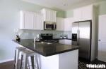 Tủ bếp gỗ sồi sơn men trắng chữ L TBT0067