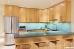 Tủ bếp gỗ Xoan Đào chữ L có quầy bar gắn liền TBT0798