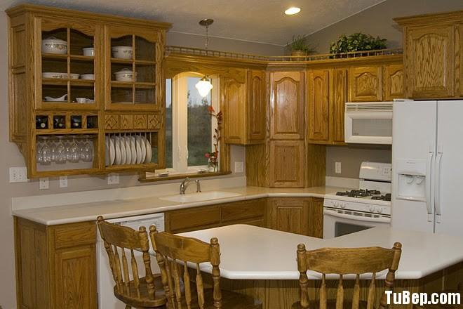 go xoan dao tay bac 1 Tủ bếp gỗ xoan đào, có bàn đảo – TBB046
