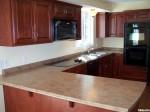 Tủ bếp gỗ tự nhiên Pơmu – TBB415