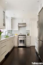 Tủ bếp gỗ Xoan Đào tự nhiên sơn men trắng hình chữ L – TBB1003
