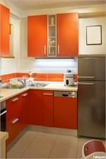 Tủ bếp Acrylic kết hợp với Laminate dạng chữ L màu cam  bóng gương tinh tế trẻ trung hiện đại– TBB2837