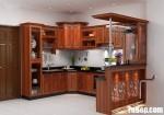 Tủ bếp gỗ tự nhiên Giáng Hương sơn PU kết hợp quầy bar cổ điển sang trọng – TBB4899
