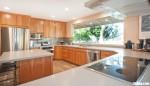 Tủ bếp gỗ Laminate vân gỗ chữ U thiết kế hiện đại – TBT3796